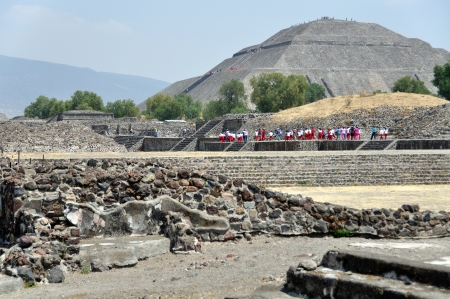 Goup of people go to the Pyramid of the Sun, Teotihuacan Pyramids, Mexico photo