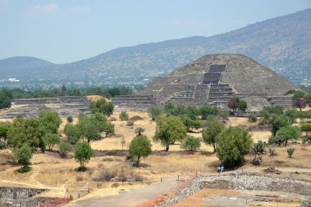 Pyramid of the Moon, Teotihuacan Pyramids, Mexico with mountain at the background photo