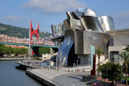 frank gehry: Guggenheim Museum in Bilbao with La Salve Bridge, Spain. Museum of modern and contemporary art designed by architect Frank Gehry. Editorial