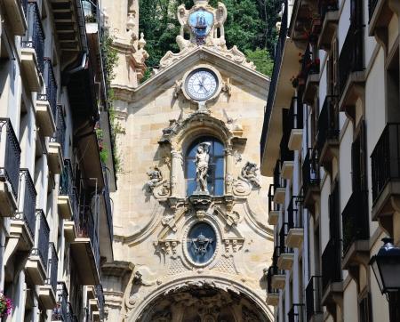 san sebastian: Facade of Old House with Clock in San Sebastian, Spain