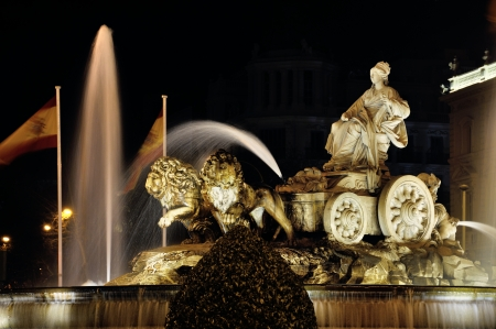 Night view of Cibeles Fountain in Madrid, Spain photo