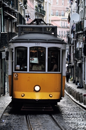bica: LISBON, PORTUGAL - JULY 27  Yellow Tram with people in Lisbon, Portugal  Trams are the symbol of the city, operating since 1873