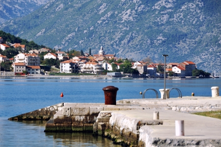 View of pier in Boka Kotorska bay with Stoliv town at the background, Montenegro photo