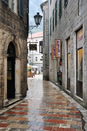 KOTOR, MONTENEGRO - NOVEMBER 3: Empty streets of famous old town and resort Kotor on November 3, 2013. It's a coastal town located in the Gulf of Kotor, old fort is part of the World Heritage Site