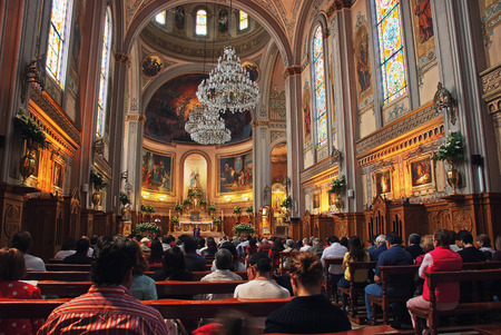 MEXICO CITY - MARCH 14, 2011: Interior of an unidentified church with people during the monday sermon