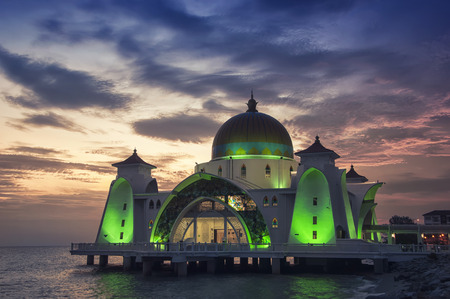 malaysia city: Malacca Straits Mosque at sunset in Malaysia located in a man-made island. It is a relatively new and very colorful mosque opened in 2006.