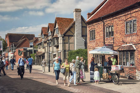 STRATFORD UPON AVON, UK - SEPTEMBER 2, 2014: The main street of very touristic town where playwright and poet William Shakespeare was born. There is a house a birthplace