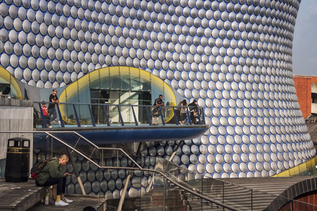 BIRMINGHAM, ENGLAND - SEPTEMBER 2, 2014: People in front of Selfridges Building designed by architecture firm Future Systems. It�s futuristic design is significant