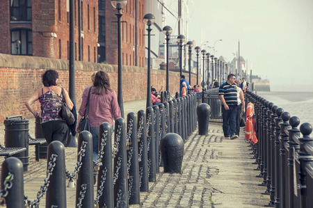 mercantile: LIVERPOOL, UK - SEPTEMBER 5, 2014: Unidentified people walking at the Albert Dock - complex of buildings and warehouses opened in 1846, part UNESCO designated World Heritage Maritime Mercantile City.