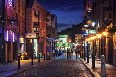 temples: DUBLIN, IRELAND - SEPTEMBER 7, 2014: Nightlife at popular historical part of the city - Temple Bar quarter. The area is the location of many bars, pubs and restaurants