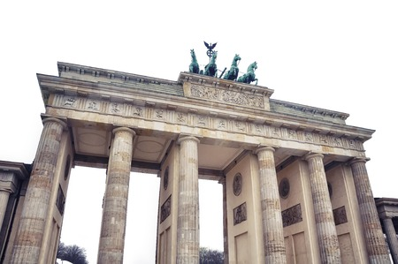 historical events: Isolated on white Brandenburg Gate - a Triumphal Arch, one of the most popular landmarks in Berlin. It is a site for major historical events and a historical symbol of the capital of Germany.