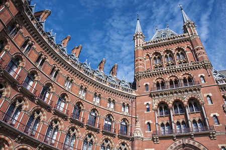 gilbert: St Pancras international railway station in London, UK known for its Victorian architecture. Designed by George Gilbert Scott in 1865. The building being polychromatic is made of brick