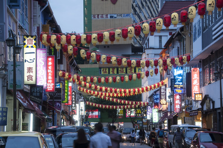 notable: SINGAPORE - MAY 18, 2014: Chinatown with notable chinese buildings, restaurants and decoration. Many tourists find there authentic food, clothes and other stuff