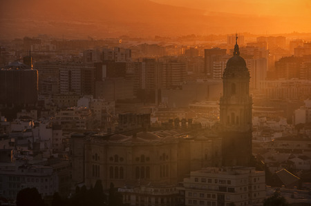 Aerial view of Malaga, Andalusia at sunset. Sunlight going through the cathedral