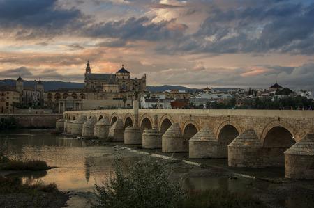 Roman bridge and La Mesquita at sunset in Cordoba, Andalusia, Spain