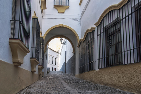 spanish homes: Empty streets of Ronda in Andalusia, Spain. Old part of the town. Stock Photo