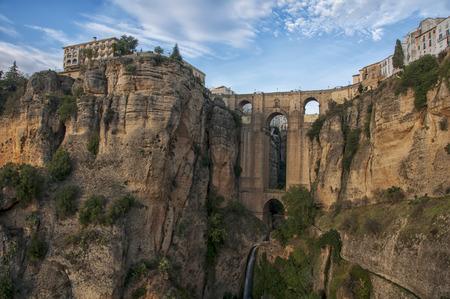 nuevo: The Puente Nuevo New Bridge over Guadalevin River in Ronda, Andalusia, Spain. Popular landmark in the evening Stock Photo