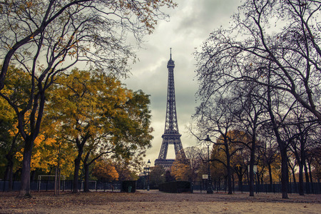 Eiffel Tower and Champ de Mars park in autumn, Paris, France. It is most-visited paid monument in the world, even in autumn its full of tourists