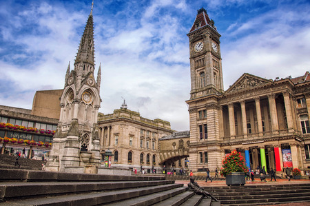 public service: BIRMINGHAM, UK - SEPTEMBER 1, 2014: Chamberlain Memorial erected in Chamberlain Square in 1880 to commemorate the public service of Joseph Chamberlain. City Council House