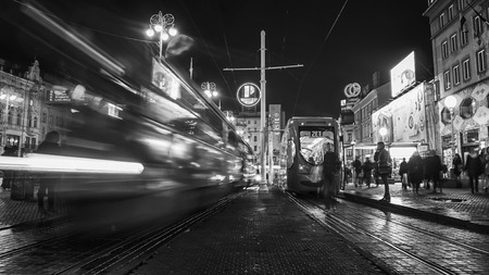 electric tram: ZAGREB, CROATIA - NOVEMBER 21, 2013: Famous blue Tram in the center with local people at night. First electric tram ran in 1910, nowadays the city tram system transport around 200 million passengers