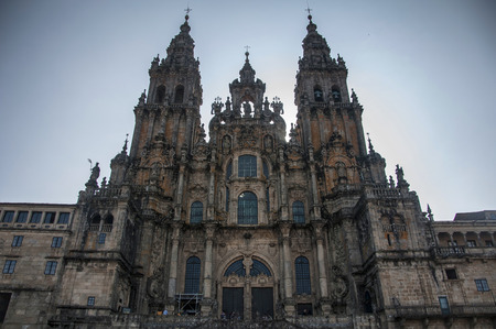 compostela: Main facade of Santiago de Compostela Cathedral, Galicia, Spain. Silhouette with direct sun from behind with vignette effect