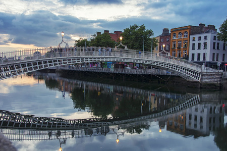 Evening view of famous HaPenny Bridge in Dublin, Ireland