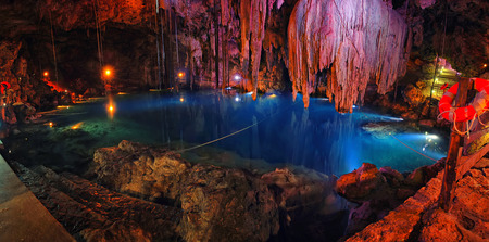 natural landmark: Inside a sinkhole - famous natural landmark Cenote in Mexico - cave with inner lake