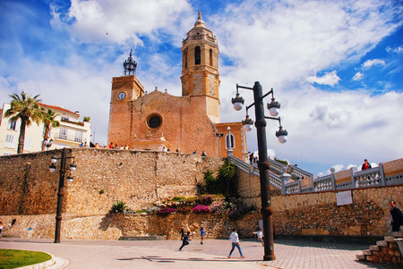 dorada: SITGES, SPAIN - APRIL 1, 2013: View of the Cathedral and promenade area of the popular touristic town in Costa Dorada. The coastal city in Catalonia is famous for its Film Festival and Carnival