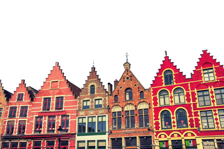 Isolated famous old colorful buildings at Market square in Bruges, Belgium. Popular Flemish city with almost intact medieval architecture