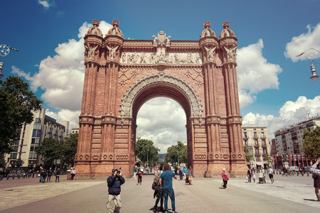 BARCELONA - APRIL 17, 2013: The Arc de Triomf is a memorial arch built in the Neo-Mudejar style as main access gate for the 1888 Barcelona World Fair.