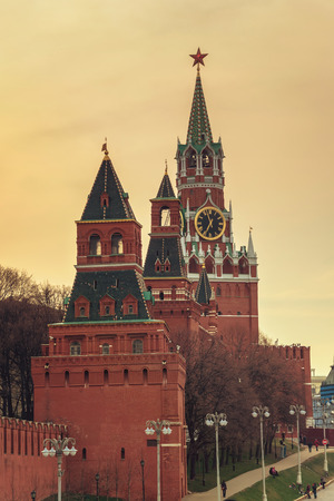spasskaya: Spasskaya Tower - the main tower on the eastern wall of the Moscow Kremlin, Russia. Twilight, toned photo Stock Photo