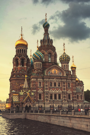 evening church: Church on Spilled Blood in the late evening at twilight. Saint Petersburg. Russia. Toned photo, cloudy sky.