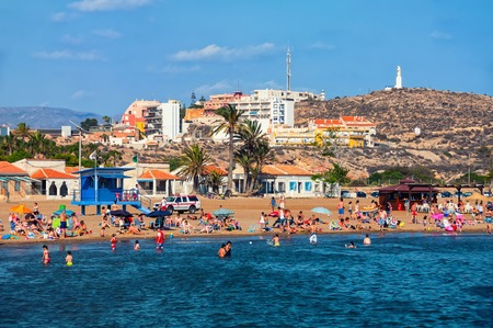 murcia: MAZARRON, SPAIN - JUNE 15, 2014: Coastline of Costa Calida in Murcia region. People at the small secure beach with Mediterranean sea - popular touristic summer resort