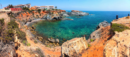 touristic: Coastline of Costa Calida in Murcia region, Spain. Small secure beach with Mediterranean sea - popular touristic summer resort Stock Photo