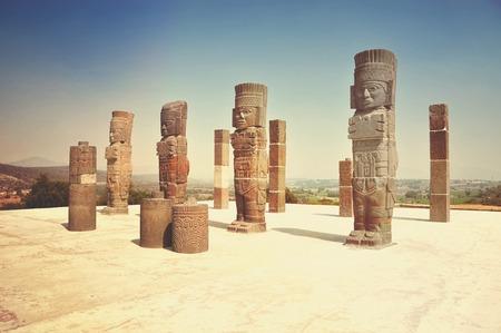 atlantes: Toltec Warriors - Atlantes - columns topping the Pyramid of Quetzalcoatl in Ancient ruins of Tula de Allende - archaeological site in Hidalgo, Mexico. Vintage effect, retro style, toning