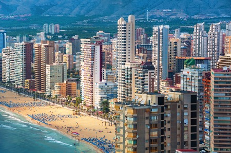beaches of spain: Aerial view of summer resort Benidorm, Spain with beach and famous skyscrapers. City has three major beaches of the maximum quality standard