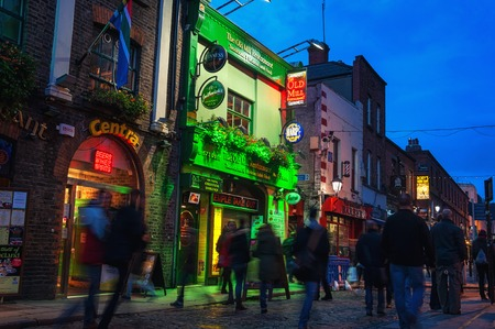 DUBLIN, IRELAND - NOVEMBER 11, 2014: Nightlife at popular historical part of the city - Temple Bar quarter. The area is the location of many bars, pubs and restaurants