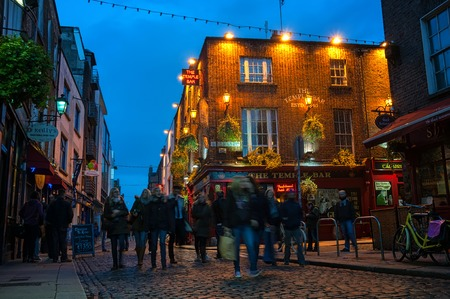 DUBLIN, IRELAND - NOVEMBER 11, 2014: Nightlife at popular historical part of the city - Temple Bar quarter. The area is the location of many bars, pubs and restaurants Editorial
