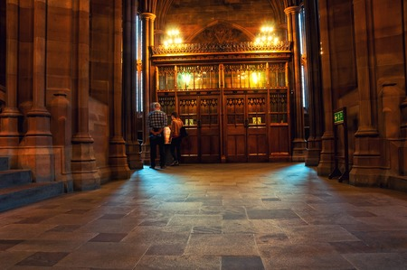 MANCHESTER, UK - SEPTEMBER 3, 2014: Inside a John Rylands Library - a late-Victorian neo-Gothic building and a famous landmark. Interior decoration with a bookshelf Editorial