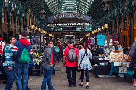 covent garden market: LONDON, UK - AUGUST 29, 2014: Unidentified people inside a Apple Market in Covent Garden. Different stalls selling handmade crafts, clothes and arts