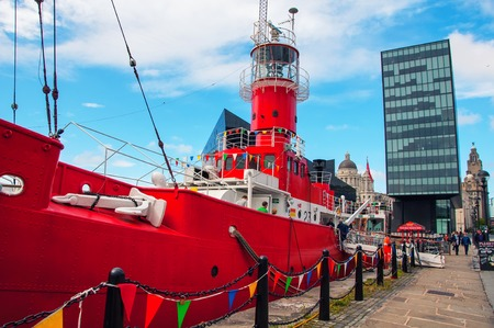 mercantile: LIVERPOOL, UK - SEPTEMBER 5, 2014: Unidentified people in Red Ship at the Albert Dock - buildings and warehouses opened in 1846, part UNESCO designated World Heritage Maritime Mercantile City. Editorial