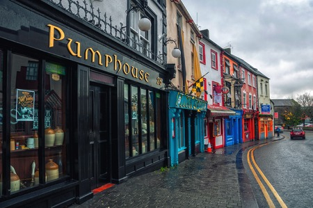 ireland: KILKENNY, IRELAND - NOVEMBER 21, 2014: Famous place in the city where stand in a row different bars and pubs. It is a popular touristic destination