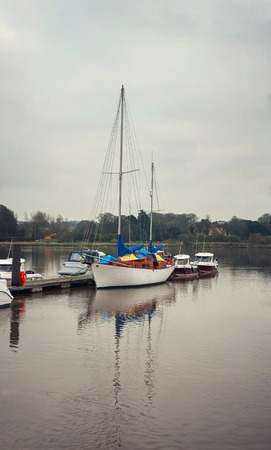 moored: Luxury yacht moored at the Waterford, Ireland port in the cloudy weather in winter