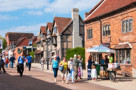 playwright: STRATFORD UPON AVON, UK - SEPTEMBER 2, 2014: The main street of very touristic town where playwright and poet William Shakespeare was born. There is a house a birthplace