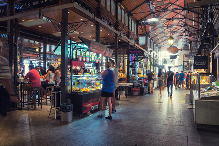 MADRID, SPAIN - JULY 22, 2015: People eat at Mercado San Miguel, which is one of the most popular places in the city. Different food stalls, drinks, seafood
