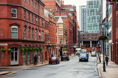 midlands: BIRMINGHAM, UK - SEPTEMBER 1, 2014: The building of Old Royal Pub an example of characteristic Victorian red brick and terracotta architecture in the center of the city during the cloudy day.
