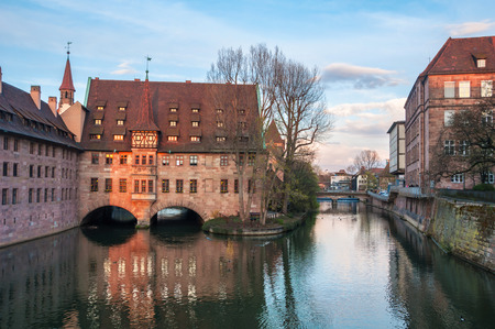 hospice: Hospice of the Holy Spirit - old architecture in the famous touristic city Nuremberg, Germany Stock Photo