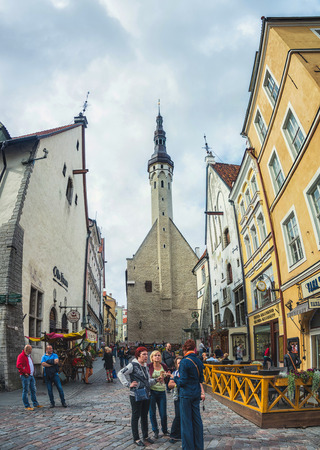 baltic people: TALLINN, ESTONIA - AUGUST 30, 2015: Old buildings, restaurants and cafes on the narrow streets in old historical area in the popular European city of Baltic region. Unidentified people tourists