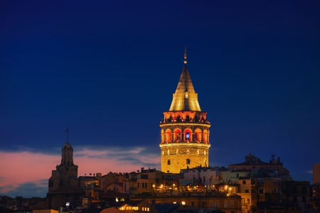 istanbul: Illuminated Galata Tower in Istanbul, Turkey with dark blue sky at the background