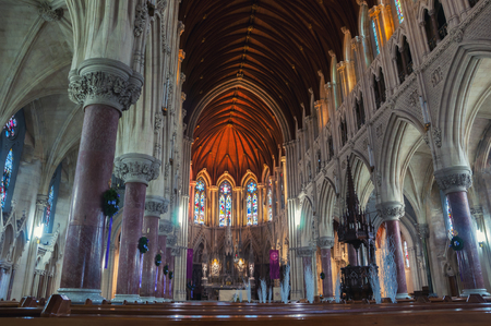 neo gothic: COBH, IRELAND - DECEMBER 6, 2014: Interiors of St Colmans Roman Catholic Cathedral - large and elaborately detailed neo Gothic building. Aisle leading up to the altar of Sicilian marble Editorial